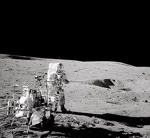 Modular Equipment Transporter - Alan Shepard stands next to the Modular Equipment Transporter.