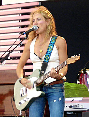 "Rave Un2 the Joy Fantastic - Sheryl Crow contributed to two of the album's songs, promotional single ""Baby Knows"" and ""Everyday Is a Winding Road""."