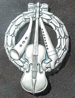 Riksspelman - The Silver Zorn Badge, designed by Anders Zorn (1860-1920)