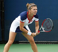 Halep in ready stance to return serve