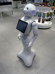 The robot Pepper standing in a retail environment