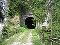 Southern entrance of the Huda luknja tunnel and a bridge.jpg