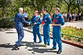 Soyuz MS-09 backup crew members receive a gift of flowers.jpg
