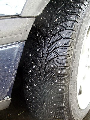 Snow tire - Snow tire with metal studs, which improve traction on icy surfaces.