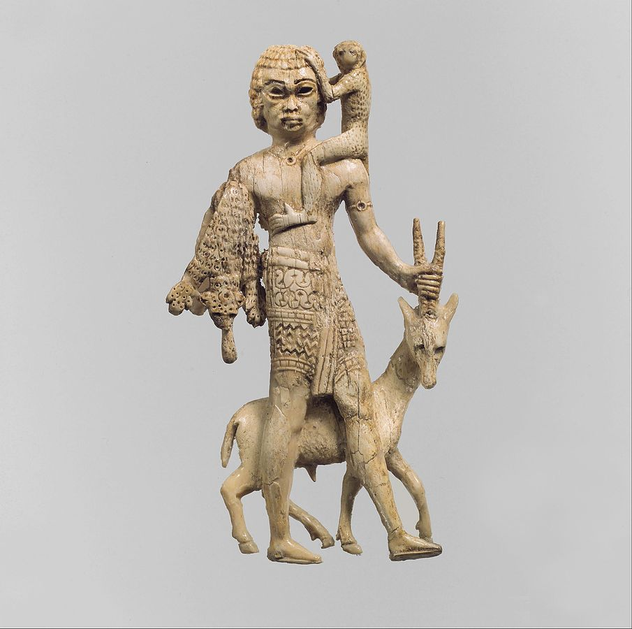 Statuette of a man with an oryx, a monkey, and a leopard skin