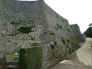 Shuri Castle - A restored wall near Kyukeimon, showing incorporated original stones.