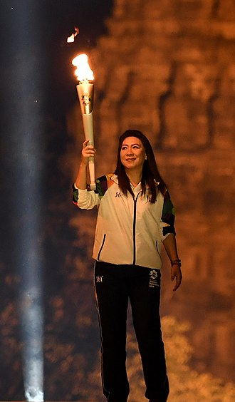 2018 Asian Games - Indonesian badminton legend Susi Susanti carried a torch fire during the Asian Games Torch Relay Concert in Yogyakarta, Indonesia