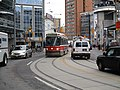 TTC streetcar visible by Dundas Square, 2015 12 01 (3) (23453943096).jpg
