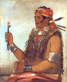 Dipinto di Tenskwatawa in abiti tradizionali con in mano oggetti religiosi