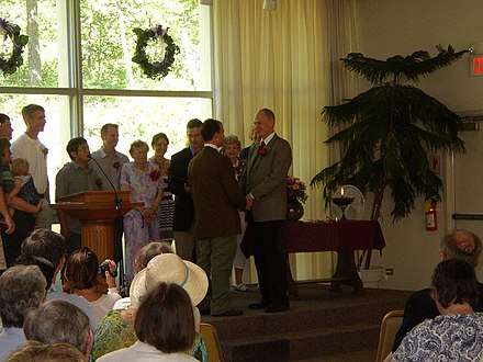 A same-sex couple exchanging wedding vows in a Unitarian Universalist Fellowship Terryandmarkwedding.jpg