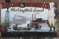 """The """"Welcome to Ravenswood"""" mural in Ravenswood, West Virginia. The George Washington reference pertains to the nation's first president's ownership of lands in the area, which was then the far LCCN2015631956.tif"""