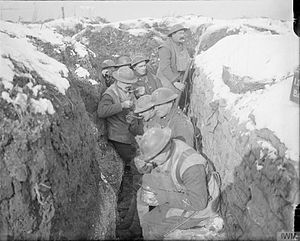 37th Brigade (United Kingdom) - Men of the 6th (Service) Battalion, Queen's (Royal West Surrey Regiment) eating dinner in the trenches, Arras, France, March 1917.