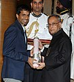 The President, Shri Pranab Mukherjee presenting the Padma Bhushan Award to Shri Pullela Gopichand, at a Civil Investiture Ceremony, at Rashtrapati Bhavan, in New Delhi on March 31, 2014.jpg
