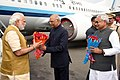 The Prime Minister, Shri Narendra Modi being welcomed by the Governor of Bihar, Shri Ram Nath Kovind and the Chief Minister of Bihar, Shri Nitish Kumar, on his arrival, at Patna Airport, in Bihar on March 12, 2016.jpg