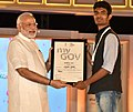 The Prime Minister, Shri Narendra Modi distributing the certificate to MyGov contest winner, at the 2nd Year Anniversary celebrations of MyGov, in New Delhi on August 06, 2016 (3).jpg