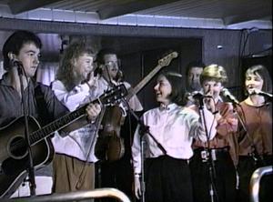 The Rankin Family - The Rankin Family performing aboard the M/S Scotia Prince, April 18, 1990. From left to right: Jimmy Rankin, Natalie MacMaster, Bruce Phillips, Raylene Rankin, John Morris Rankin, Cookie Rankin, Heather Rankin.