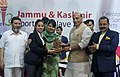 The Union Home Minister, Shri Rajnath Singh presenting the awards to the sportspersons, at the Jammu and Kashmir Sports Conclave-2018, in Srinagar, Jammu & Kashmir.JPG