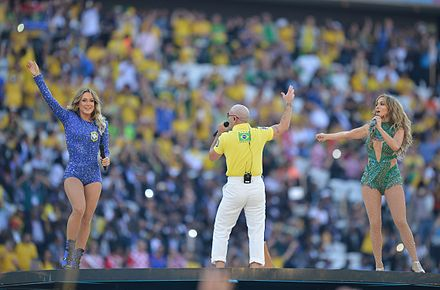 From left to right: Claudia Leitte, Pitbull, and Jennifer Lopez performing at the opening ceremony at the Arena de Sao Paulo, Sao Paulo. The opening ceremony of the FIFA World Cup 2014 10.jpg