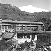 Black-and-white photo of the exterior of a hydroelectric plant