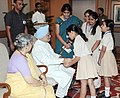 The school children tying 'Rakhi' to the Prime Minister, Dr. Manmohan Singh, on the occasion of 'Raksha Bandhan', in New Delhi on August 21, 2013. Smt. Gursharan Kaur is also seen (1).jpg