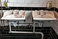 Thomas Crapper sinks at The Parcel Yard, King's Cross Station, London England.jpg