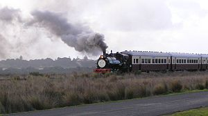 Tourist and Heritage Railways Act - A tourist and heritage train with a Thomas the Tank Engine face travelling westwards through Swan Bay saltmarsh on the Bellarine Railway. The Bellarine Railway is a volunteer-operated steam-driven tourist railway located in Victoria, Australia. It operates on a 16 km section of a formerly disused branch line on the Bellarine Peninsula between the coastal town of Queenscliff and Drysdale, near Geelong in regional Victoria.