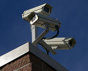 Three surveillance cameras on the corner of a ...