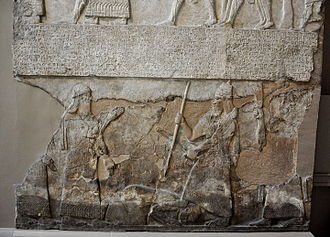 Tiglath-pileser III stands over an enemy, bas-relief from the Central Palace at Nimrud. Tiglath-pileser III stands over an enemy, bas-relief from the Central Palace at Nimrud..JPG