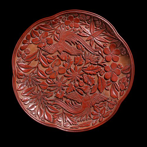 Carved lacquer tray with two birds against a background of plum blossom and flowers, 19 cm wide, 13th century Tray (Pan) in the Form of a Plum Blossom with Birds and Flowers LACMA M.86.330 (1 of 2).jpg