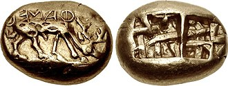 Coin - The earliest inscribed coinage: electrum coin of Phanes from Ephesus, 625-600 BC. Obverse: Stag grazing right, ΦΑΝΕΩΣ (retrograde). Reverse: Two incuse punches, each with raised intersecting lines.