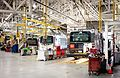 Trolleybuses being serviced inside Vancouver Transit Centre (garage) in 2012.jpg