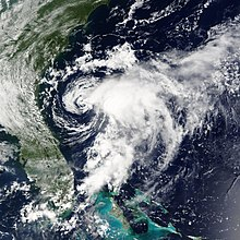 Satellite imagery of a disorganized tropical storm near its peak intensity.