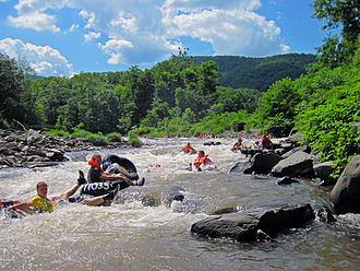 Tubing (recreation) - Free-floating tubers on Esopus Creek in the Catskill Mountains of New York