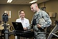 U.S. Army Spc. Kevin Thomas, assigned to the 863rd Engineer Battalion, interacts with Joni Garcia Hunter, a physical therapy assistant with the health and wellness division at the Argonne National Laboratory 140826-A-TI382-627.jpg