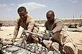 U.S. Marine Corps Cpl. Wilmer Rivas, left, and Cpl. Joshua Carnegie, both assigned to Delta Company, 1st Tank Battalion, work together to prepare a tank track while conducting maintenance on an M88A2 Hercules 130507-M-YH552-074.jpg