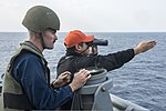 U.S. Navy Ensign Drew Finneran and Lt. j.g. Fancisco Lopez, both assigned to the amphibious transport dock ship USS Denver (LPD 9), maintain a visual watch on a floating small-arms target during a live-fire 140310-N-ZU025-197.jpg