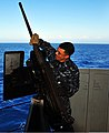 U.S. Navy Gunner's Mate 3rd Class Ruben Salazar removes the hot barrel of an M2 .50 caliber machine gun in a live-fire exercise during a friends and family day cruise aboard the dock landing ship USS 120808-N-YQ852-227.jpg