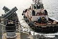 U.S. Sailors assigned to the guided missile Cruiser USS Chosin (CG 65) pull in the towing line from a tug boat during a sea and anchor evolution in Singapore Aug. 26, 2013 130826-N-WT787-001.jpg