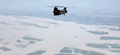 US Army helicopter flies over a flood-affected area of Pakistan Cut.png
