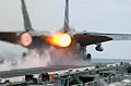 US Navy 021109-N-1810F-017 After burners on an F-14 Tomcat fire as the aircraft makes a cataputl launch.jpg