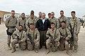 US Navy 041224-M-8096K-064 Secretary of Defense (SECDEF), Donald Rumsfeld takes a photo with some Marines at Camp Fallujah, Iraq.jpg