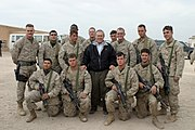 US Navy 041224-M-8096K-064 Secretary of Defense (SECDEF), Donald Rumsfeld takes a photo with some Marines at Camp Fallujah, Iraq