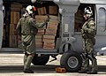 US Navy 050104-N-9403F-138 Air crewmen prepare to board an HH-60H Seahawk helicopter that is fully loaded with food and water.jpg