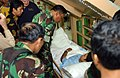 US Navy 050210-N-6504N-001 Commander of the Indonesian government disaster relief operation in Banda Aceh, Maj. Gen. Bambang Darmono, talks with an Indonesian patient aboard the Military Sealift Command (MSC) hospital ship USNS.jpg