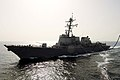 US Navy 050604-N-4309A-069 The Arleigh Burke-class guided missile destroyer USS Mustin (DDG 89) cruises alongside fast combat support ship USS Camden (AOE 2) as she conducts a replenishment at sea (RAS).jpg