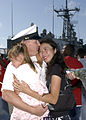 US Navy 060524-N-1550W-001 Aviation Electronics Technician Riddle hugs his wife and daughter after returning from deployment aboard guided missile frigate USS Simpson (FFG 56).jpg