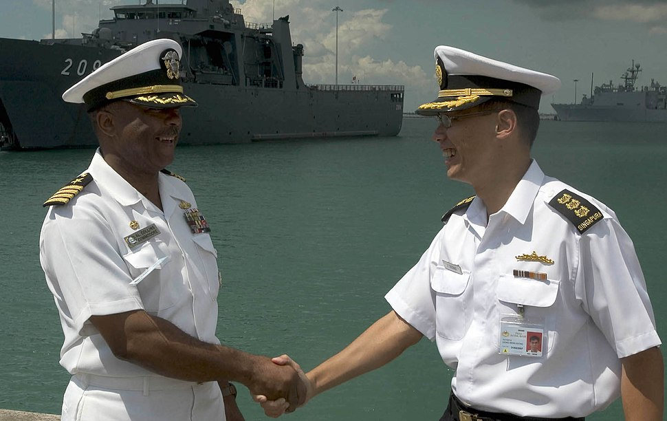 US Navy 060530-N-9851B-007 Commander, Destroyer Squadron One, Capt. Al Collins, shake hands with Col. Joseph Leong, commander of the Republic of Singapore Navy's first flotilla (cropped)