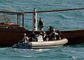 US Navy 070209-N-8623S-014 Sailors stationed aboard guided missile destroyer USS Ramage (DDG 61) board a regional fishing dhow while conducting visit, board, search and seizure (VBSS) operations in the Persian Gulf.jpg