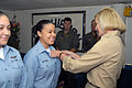US Navy 070615-N-4124C-008 Air Traffic Controller Airman Alicia M. Wayman, of Tactical Squadron 12, receives her Enlisted Air Warfare Specialist (EAWS) pin from Commander, Expeditionary Strike Group (ESG) 7, Rear Adm. Carol M.jpg