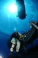 US Navy 070731-N-3093M-018 A Navy diver stands by to assist a special operator, both from SEAL Delivery Team (SDV) 2, with SDV operations with the nuclear-powered submarine USS Florida (SSGN 728) for material certification.jpg
